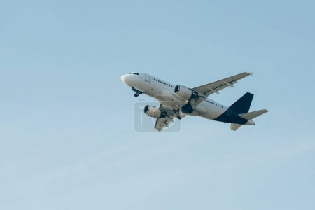 Low angle view of airplane in blue sky