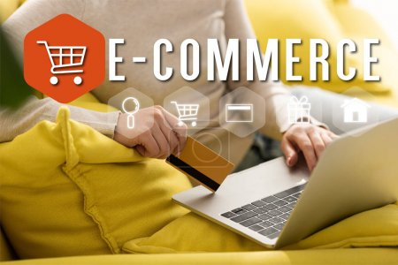 Photo for Cropped view of woman holding credit card and using laptop near illustration, e-commerce concept - Royalty Free Image