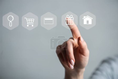 Photo for Cropped view of woman pointing with finger on gift illustration isolated on grey - Royalty Free Image