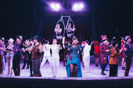 KYIV, UKRAINE - NOVEMBER 1, 2019: Artist and air gymnasts performing on circus arena