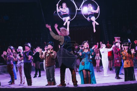 Photo for KYIV, UKRAINE - NOVEMBER 1, 2019: Selective focus of performers applauding at circus arena - Royalty Free Image