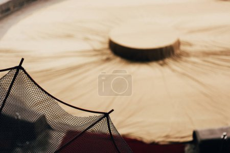 Selective focus of net and covered circus arena