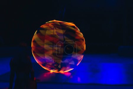 Photo for Colorful neon circle in motion on black background - Royalty Free Image