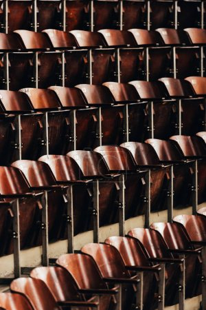 Photo for Selective focus of rows of empty wooden seats in circus - Royalty Free Image