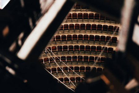 High angle view of rows of seats and constructions in circus, selective focus