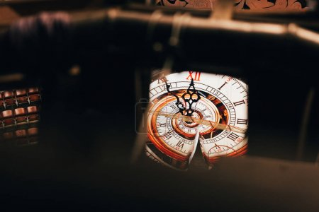 Selective focus of vintage wall clock in circus