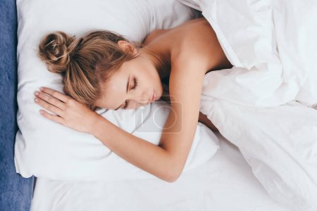 Photo for Attractive young woman sleeping in bed in morning - Royalty Free Image