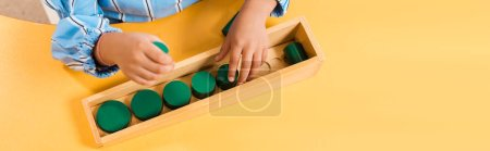 Photo for High angle view of child playing wooden educational game in montessori school, panoramic shot - Royalty Free Image