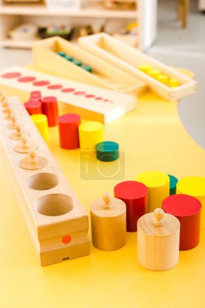 Photo for Selective focus of wooden games on yellow desk in school - Royalty Free Image