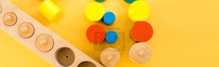 Photo for Top view of wooden educational games on yellow background, panoramic shot - Royalty Free Image