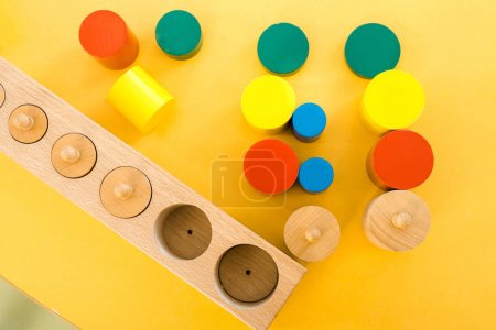Photo for Top view of colorful educational games on yellow desk in class - Royalty Free Image