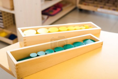 Photo for Selective focus of wooden educational games on yellow desk in class - Royalty Free Image