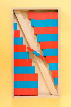 Photo for Top view of educational game with red and blue blocks on yellow background - Royalty Free Image