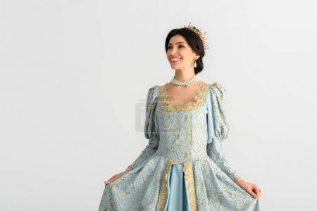 Photo pour Smiling queen with crown looking away isolated on grey - image libre de droit