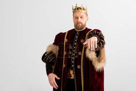 Photo pour Beau roi avec couronne montrant main isolée sur gris - image libre de droit