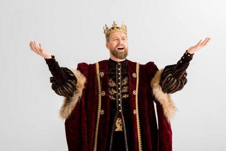 Photo pour Beau roi avec couronne criant isolé sur gris - image libre de droit