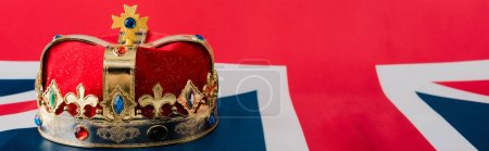 panoramic shot of golden crown on british flag
