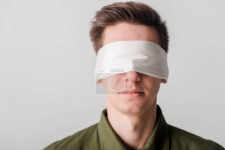 Photo for Blindfolded man isolated on white, human rights concept - Royalty Free Image