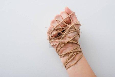 Photo pour Crochet vue d'une fille avec la main liée isolée sur blanc, concept des droits de la personne - image libre de droit