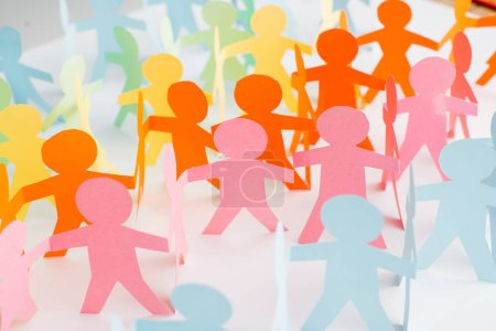 colorful paper cut chain people on white, human rights concept