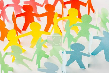colorful paper cut connected people on white, human rights concept