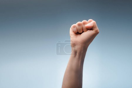 Photo for Cropped view of man with clenched fist on grey, human rights concept - Royalty Free Image