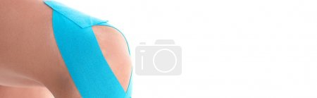 Photo for Cropped view of kinesiology tapes on knee of woman isolated on white, panoramic shot - Royalty Free Image