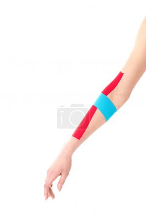 Photo for Cropped view of kinesiology tapes on woman hand isolated on white - Royalty Free Image