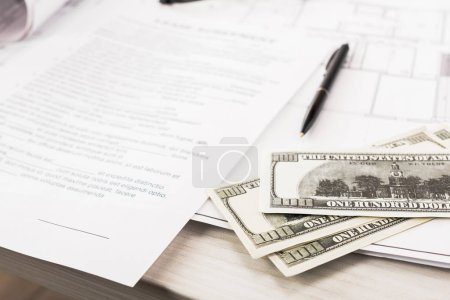 Photo for Selective focus of dollar banknotes near documents and pen on desk - Royalty Free Image