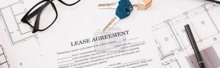 Photo for Panoramic shot of document with lease agreement lettering near glasses, blueprints and keys on desk - Royalty Free Image