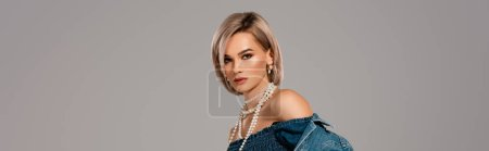 Photo for Panoramic shot of attractive woman in denim jacket looking at camera isolated on grey - Royalty Free Image