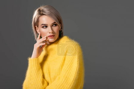 Photo for Attractive woman in yellow dress looking away isolated on grey - Royalty Free Image