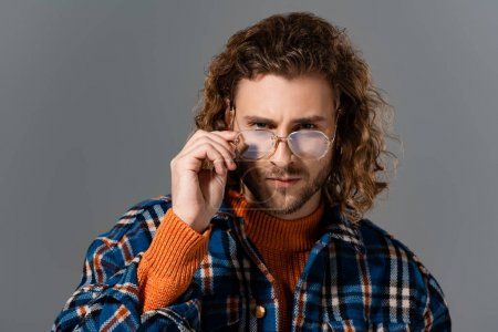 Photo for Serious man in shirt and glasses looking at camera isolated on grey - Royalty Free Image