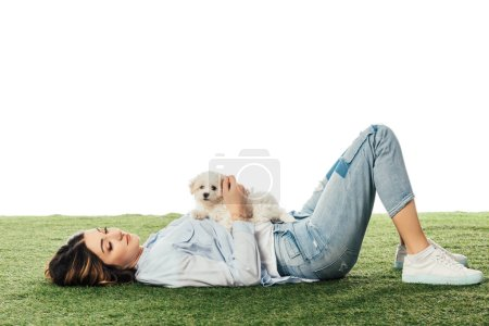 Photo for Woman with Havanese puppy lying on grass isolated on white - Royalty Free Image