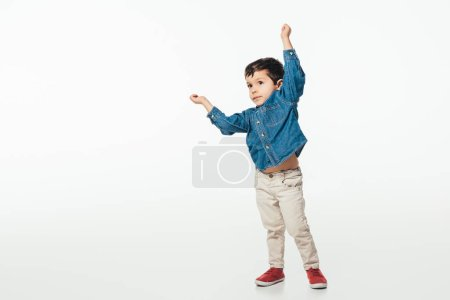 cute boy in denim shirt showing yes gesture on white background