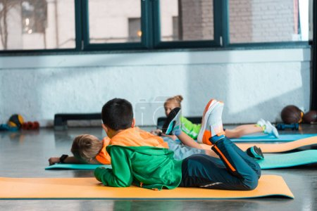 Photo for Selective focus of children lying on fitness mats in gym - Royalty Free Image