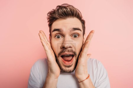 Photo for Shocked man with crazy face expression looking at camera on pink background - Royalty Free Image