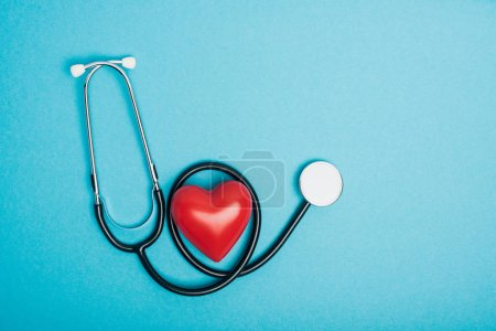 Photo for Top view of decorative red heart with stethoscope on blue background, world health day concept - Royalty Free Image