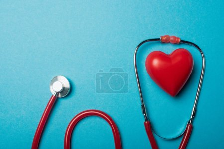 Photo for Top view of red heart and stethoscope on blue background, world health day concept - Royalty Free Image