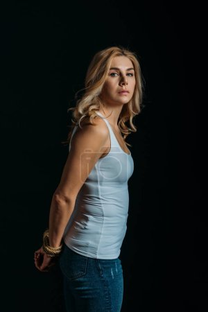 Photo for Victim with tied hands looking at camera isolated on black - Royalty Free Image