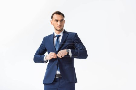 Photo pour Successful young businessman in blue suit isolated on white - image libre de droit