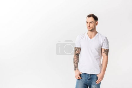 Photo for Handsome young tattooed man in jeans posing isolated on white - Royalty Free Image