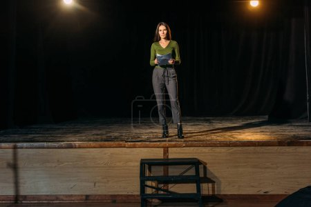 Photo for Beautiful actress standing on stage in theatre - Royalty Free Image