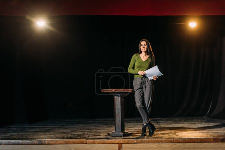 Photo for Beautiful actress performing role on stage in theatre - Royalty Free Image