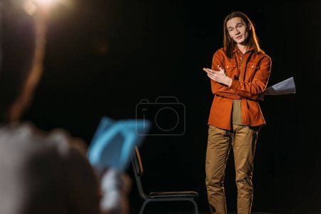 Photo for Selective focus of handsome actor on casting with theater director - Royalty Free Image