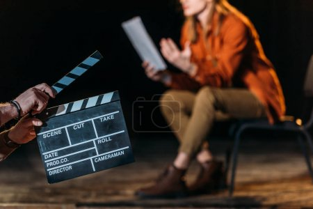 Photo for Selective focus of actor with clapboard in front - Royalty Free Image