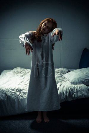 Photo for Creepy demonic woman in nightgown standing in bedroom - Royalty Free Image