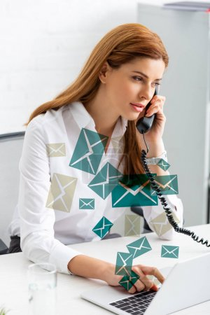 Photo for Successful businesswoman using laptop and talking on phone at office table, e-mail illustration - Royalty Free Image