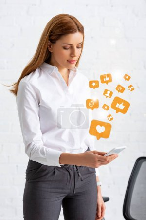 Photo for Attractive businesswoman using smartphone in office, social media illustration - Royalty Free Image