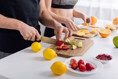 Photo for Cropped view of man and woman preparing fruit salad - Royalty Free Image